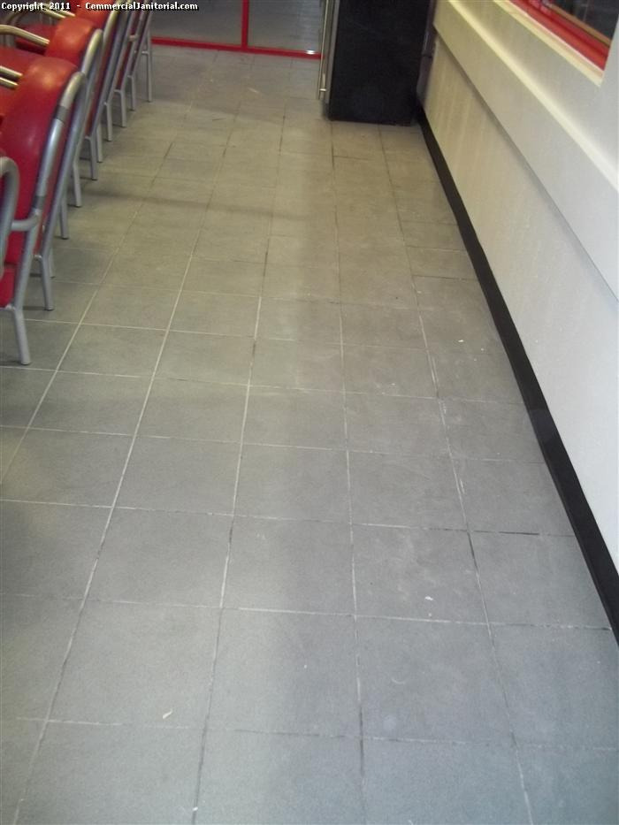 here is a before picture of ceramic floors during the construction project. Note the debris all over the floor.