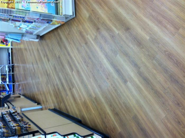 In this picture we have the wood floor with no shine, and what we did to this floor is restore it to get that nice and even shine back. first you dust mop the are in with you are going to work, then you apply your restorer with a mop and as you go you need to be removing all the stickers and scuff marks from the floor. Ones the restorer is dry then you can burnish the floor to get the shine back.