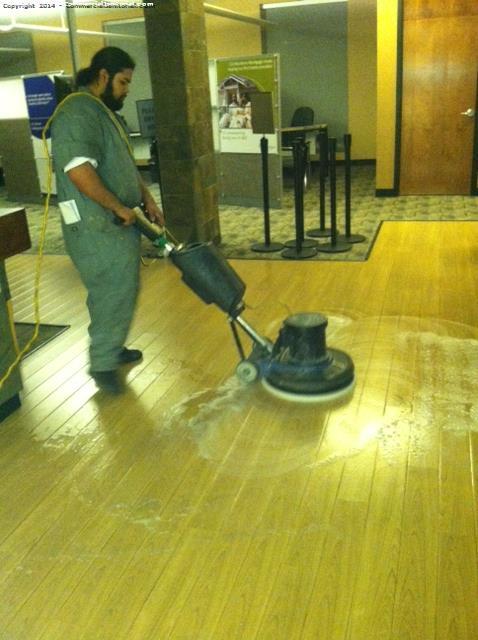 Machine Scrub Wood Floors With White Pad Image