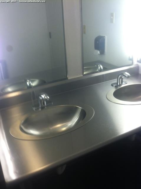 clean stainless steel sinks as part of nightly janitorial services