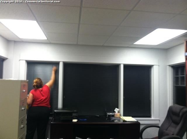 dusting of blinds in executive office image rh commercialjanitorial com