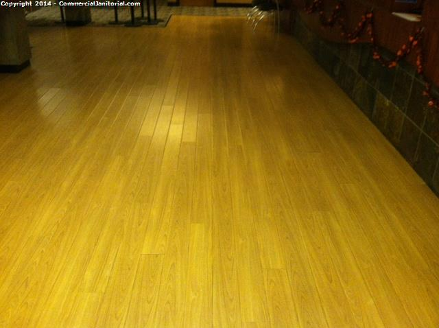 Machine Scrubbing Wood Floors With Red And White Pad Image