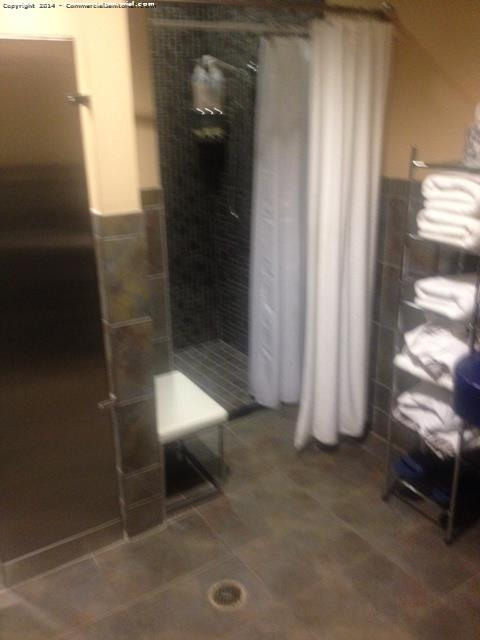 All showers were cleaned  , the towel rack was restocked , and floor was properly mopped .