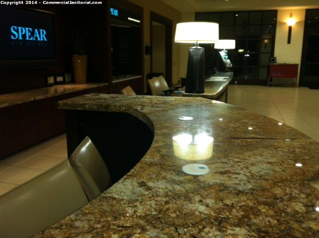 Reception desk granite counter top cleaning by the janitors and office cleaners