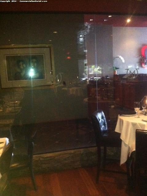 Bar and restaurant interior glass wall cleaning service