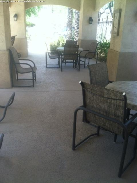 Cleaning patio chairs and tables as part of exterior porter services