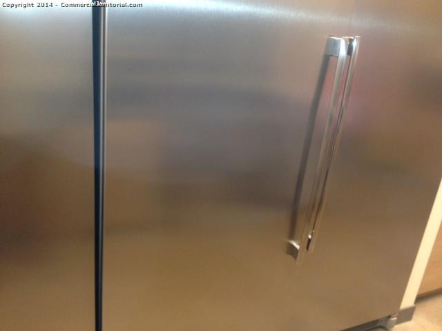 stainless steel fridge cleaning as part of nightly janitorial