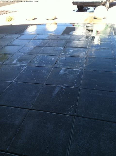 wet pavers after they are scrubbed