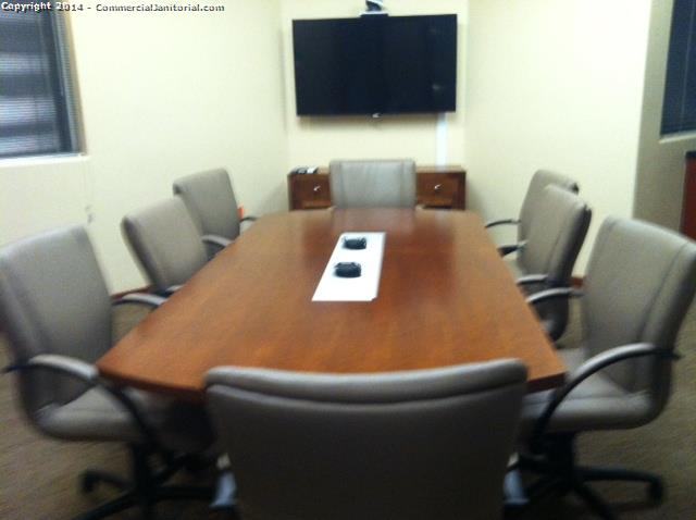 Clean and organize a conference room in a bank
