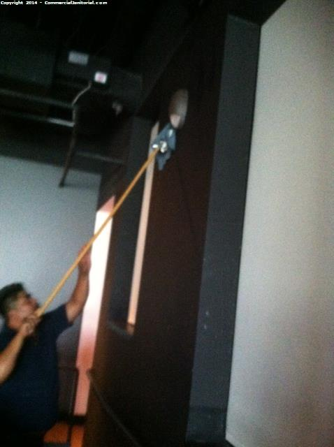 Use poles to clean walls is part of nightly janitorial service