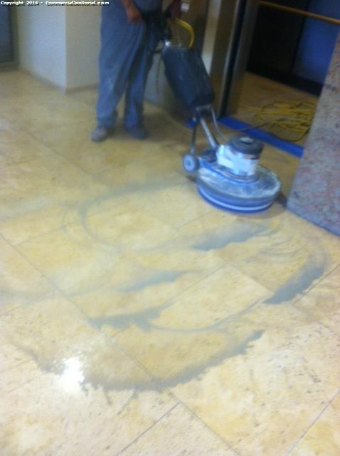 Cleaning the travertine floors before we polish them