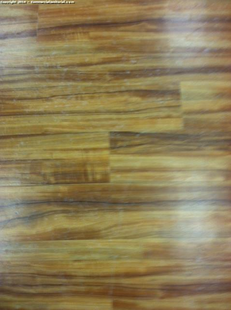 Machine Scrub Wood Floors In Gym Image