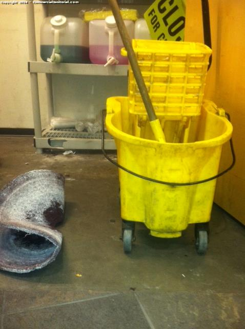 A cleaning crew must clean their mop buckets after doing floor services