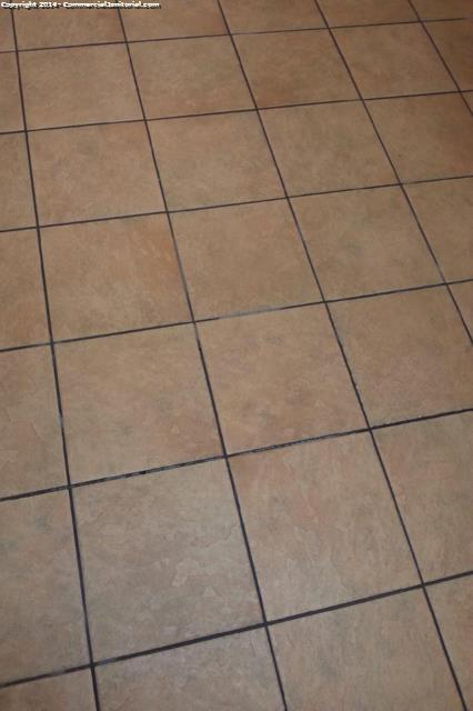 Close up of clean ceramic floor after mopping a bank