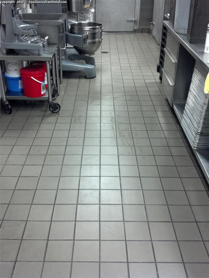 routine floor cleaning in a restaurant quarry tile.